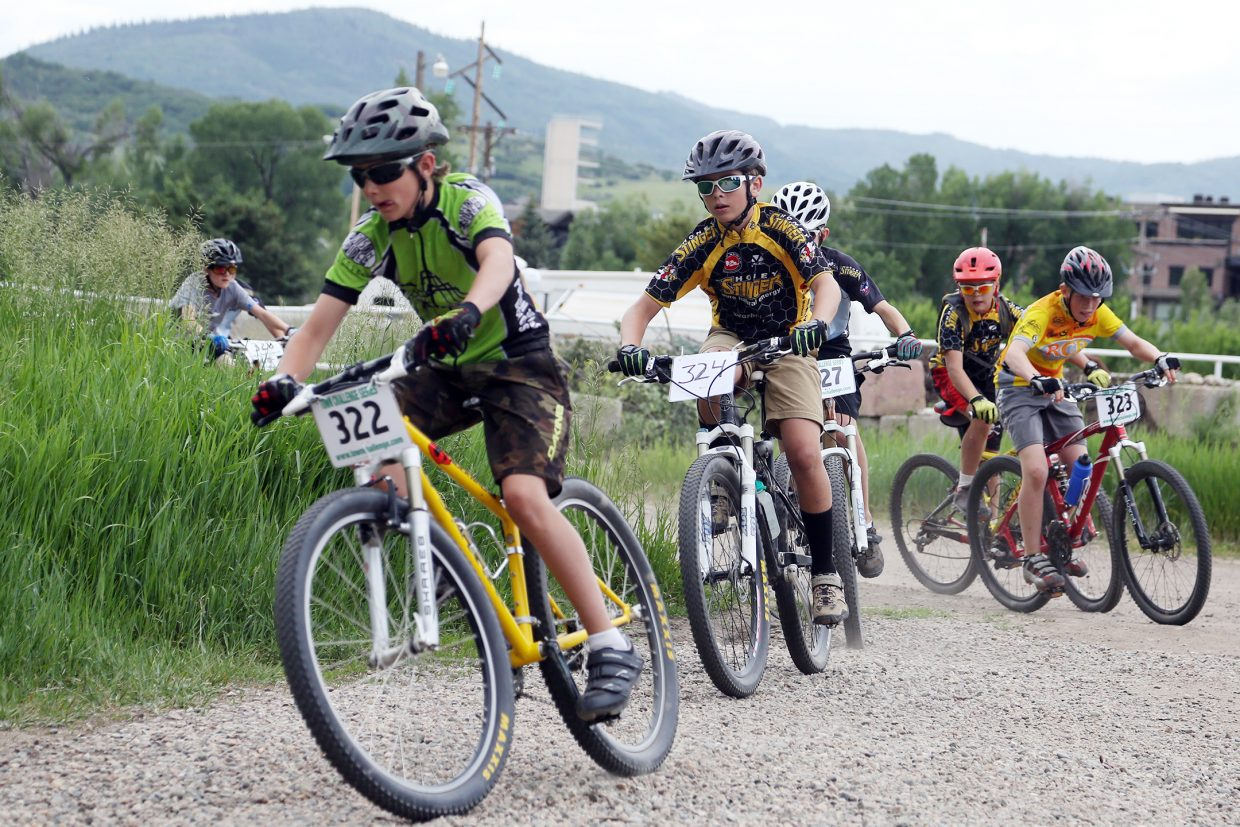Bikers compete in the youth male 11 to 12 division of the Emerald Envy XC Town Challenge mountain bike race on June 24, 2015, at Emerald Mountain in Steamboat Springs.