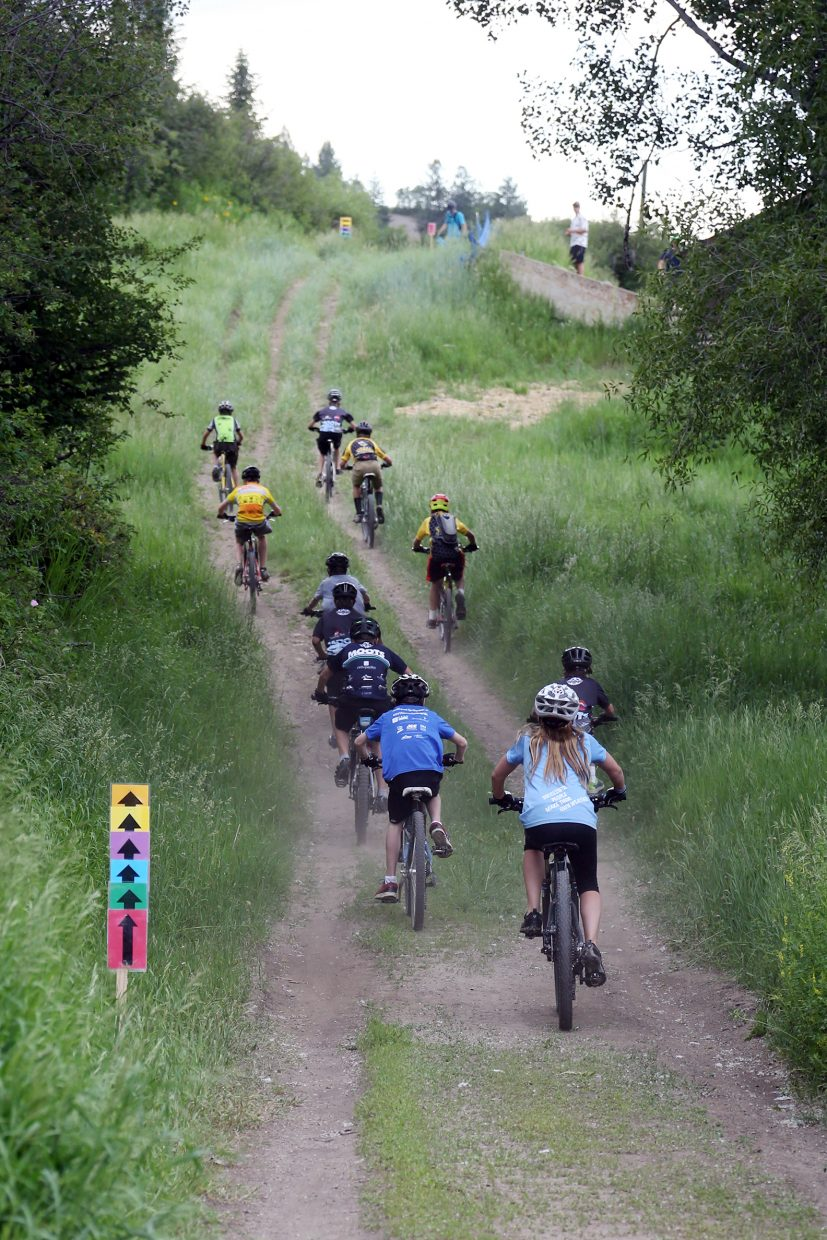 Bikers compete in the Emerald Envy XC Town Challenge mountain bike race on June 24, 2015, at Emerald Mountain in Steamboat Springs.