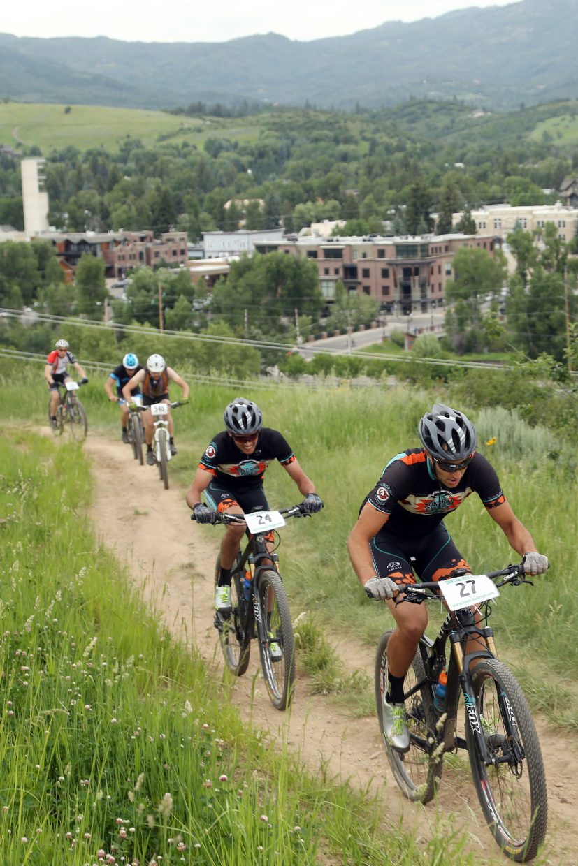 Alex Pond, far right, leads Peter Kalmes during the men's pro/open division of the Emerald Envy XC Town Challenge mountain bike race on June 24, 2015, at Emerald Mountain in Steamboat Springs.