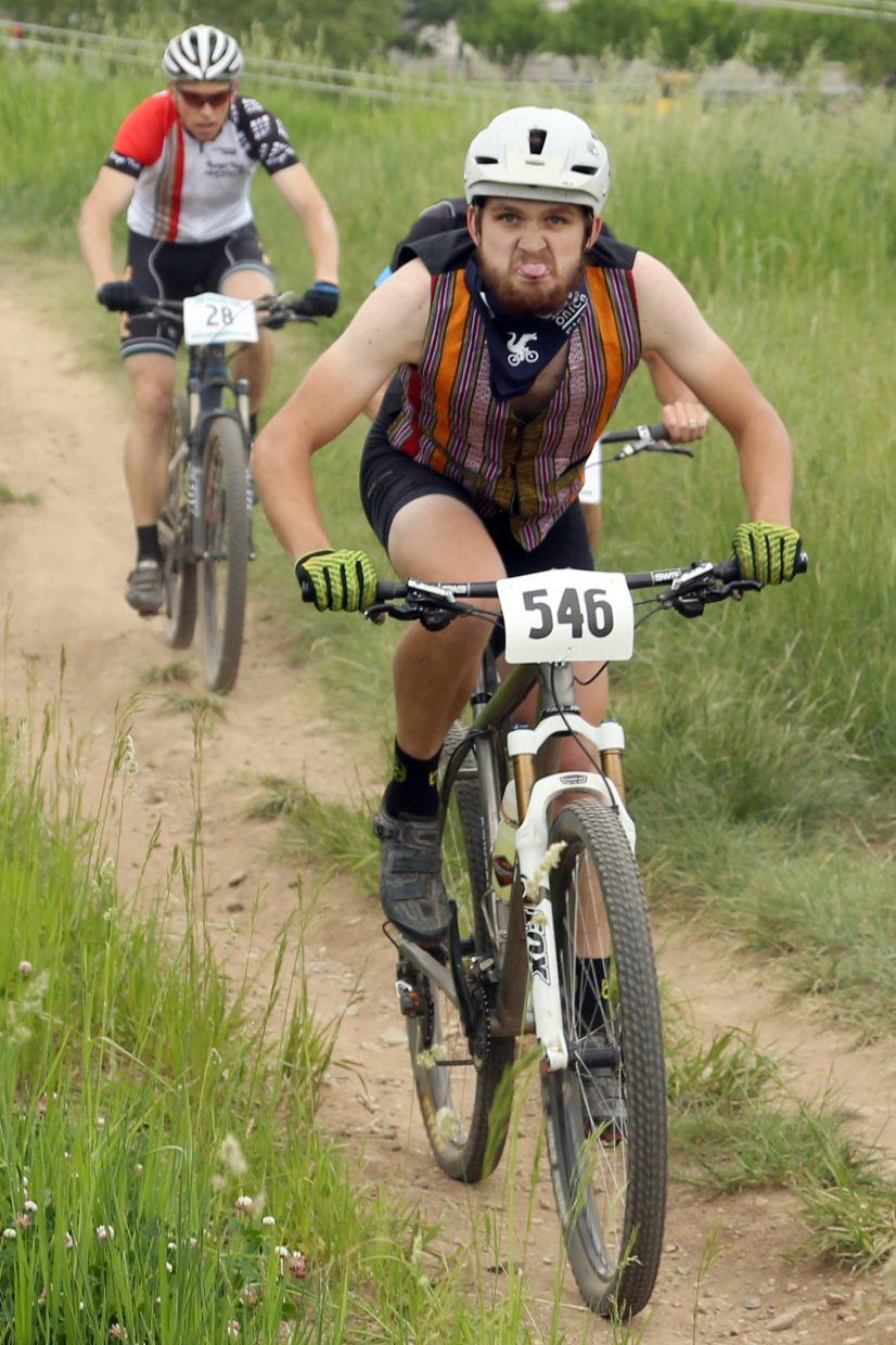 Greg Krieger, right, embraces the camera during the men's pro/open race of the Emerald Envy XC Town Challenge mountain bike race on June 24, 2015, at Emerald Mountain in Steamboat Springs.