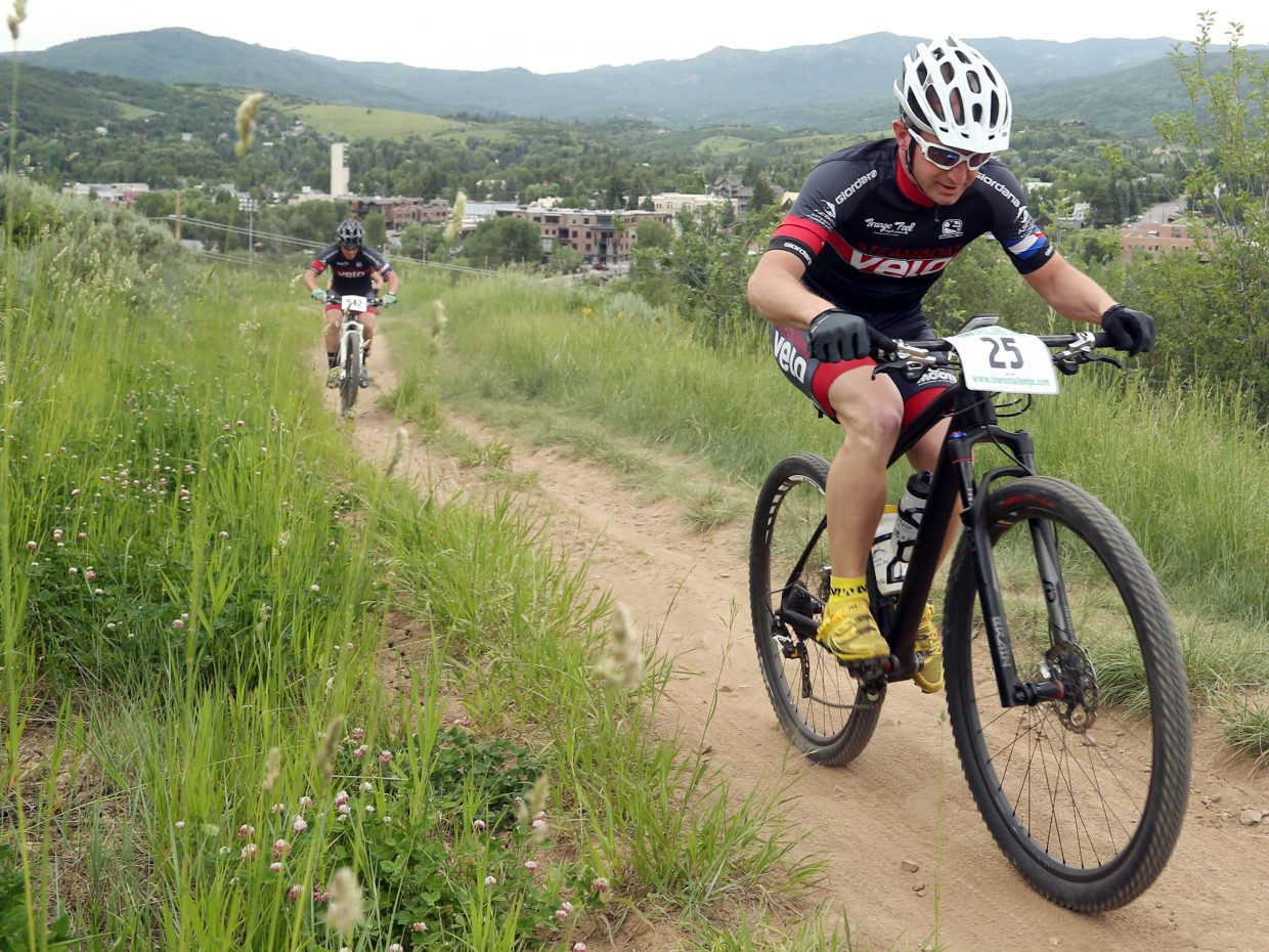 Alex Meininger, right, competes in the men's pro/open division of the Emerald Envy XC Town Challenge mountain bike race on June 24, 2015, at Emerald Mountain in Steamboat Springs.
