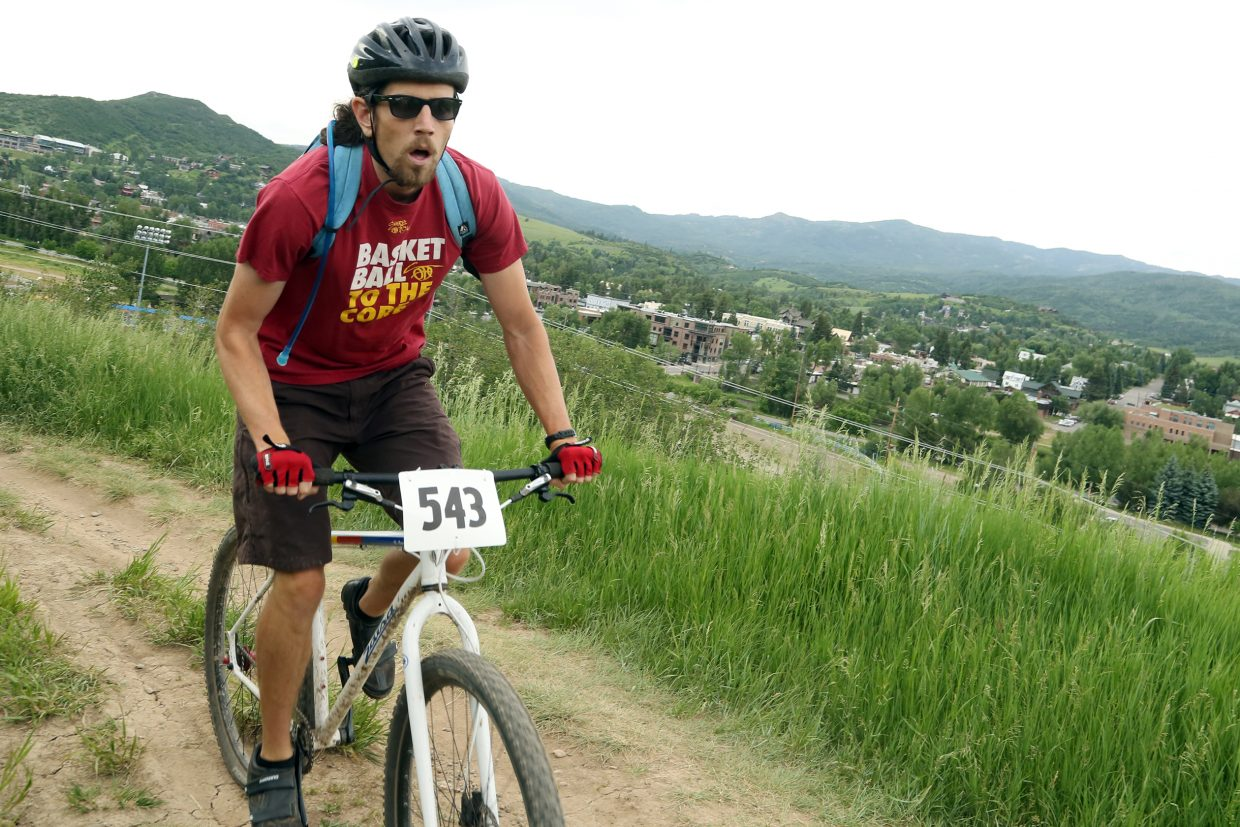 Matthew Lundy competes in the men's single speed division of the Emerald Envy XC Town Challenge mountain bike race on June 24, 2015, at Emerald Mountain in Steamboat Springs.