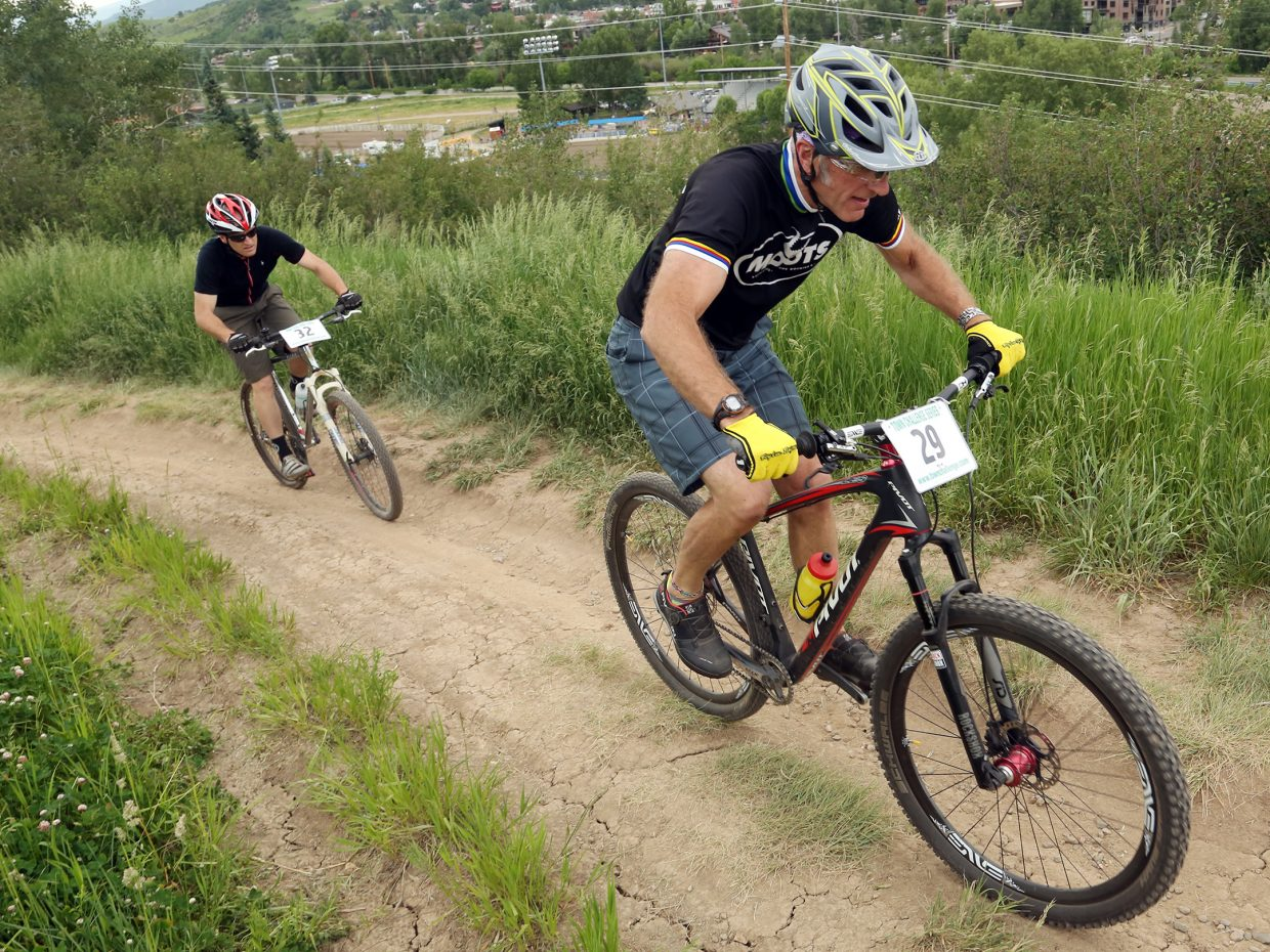 J.P. Pougiales, right, and Dan Dannerson compete in the men's single speed division of the Emerald Envy XC Town Challenge mountain bike race on June 24, 2015, at Emerald Mountain in Steamboat Springs.