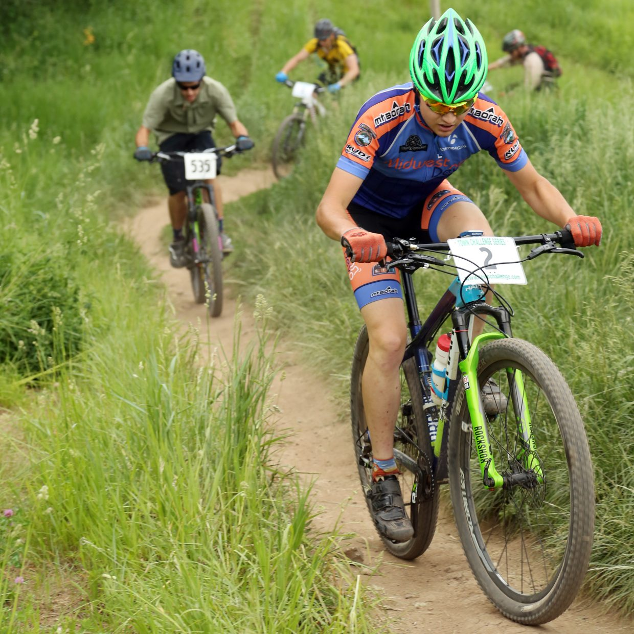 Alex Schultz, right, competes in the men's expert 19 to 34 division of the Emerald Envy XC Town Challenge mountain bike race on June 24, 2015, at Emerald Mountain in Steamboat Springs.