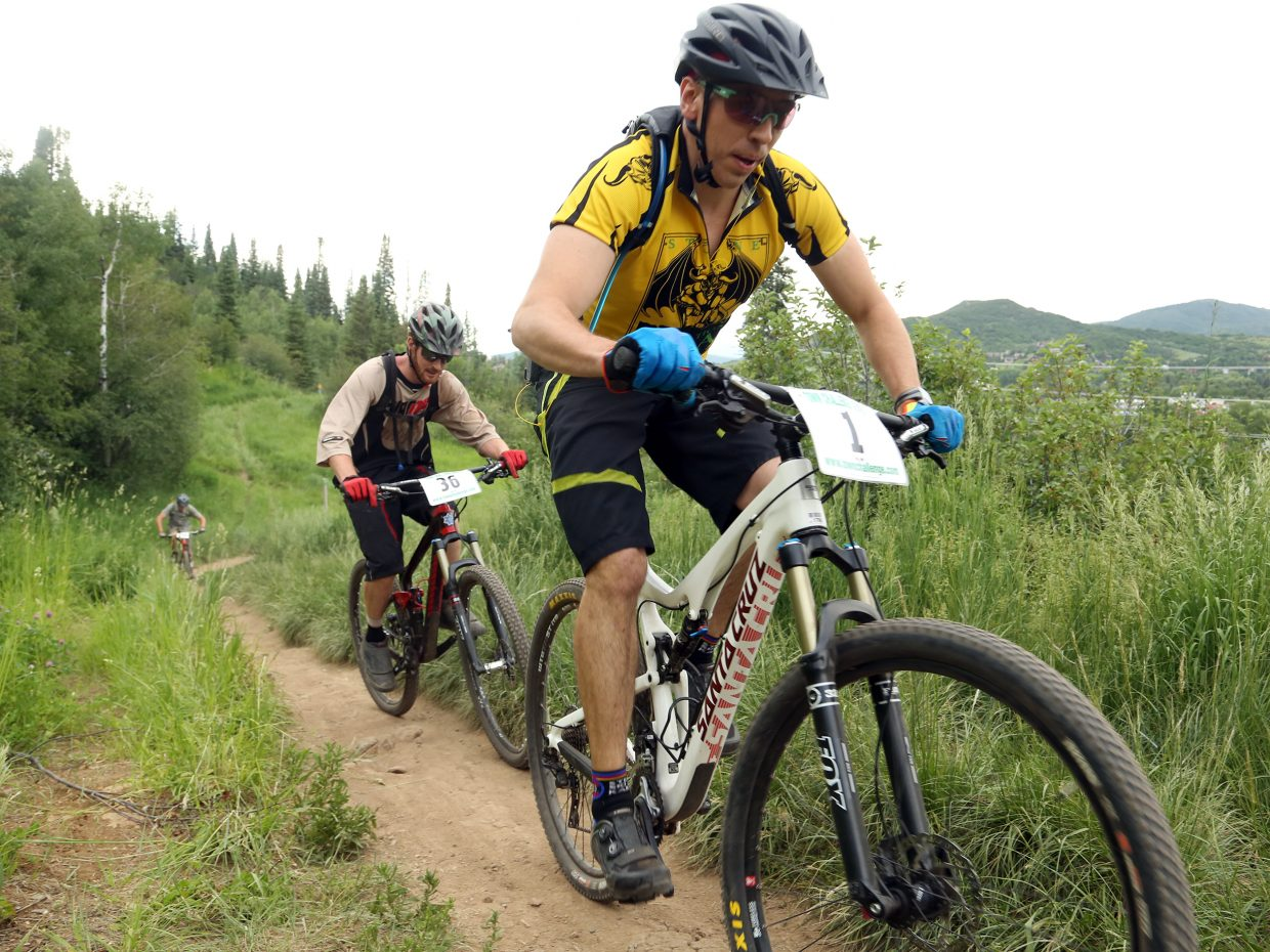Dylan Erhart, right, leads Chris Rhodes in the men's expert 19 to 34 division of the Emerald Envy XC Town Challenge mountain bike race on June 24, 2015, at Emerald Mountain in Steamboat Springs.