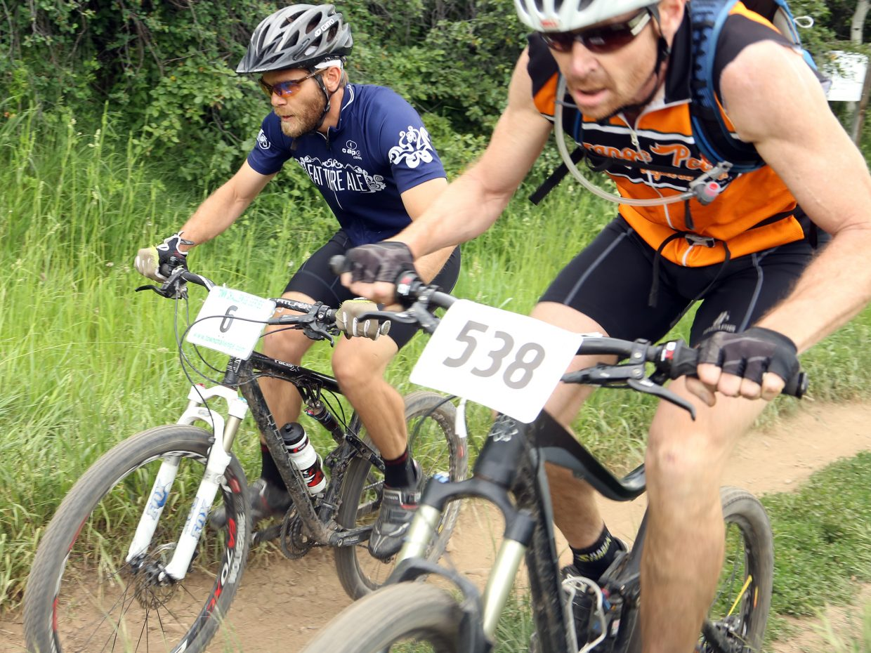 Casey Homuth, left, and Chris Mitchell battle for position during the men's expert 35 to 49 division race of the Emerald Envy XC Town Challenge mountain bike race on June 24, 2015, at Emerald Mountain in Steamboat Springs.
