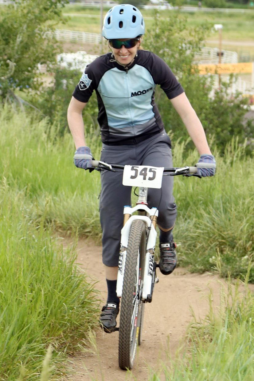 Lacey Lebaron competes in the women's single speed division of the Emerald Envy XC Town Challenge mountain bike race on June 24, 2015, at Emerald Mountain in Steamboat Springs.