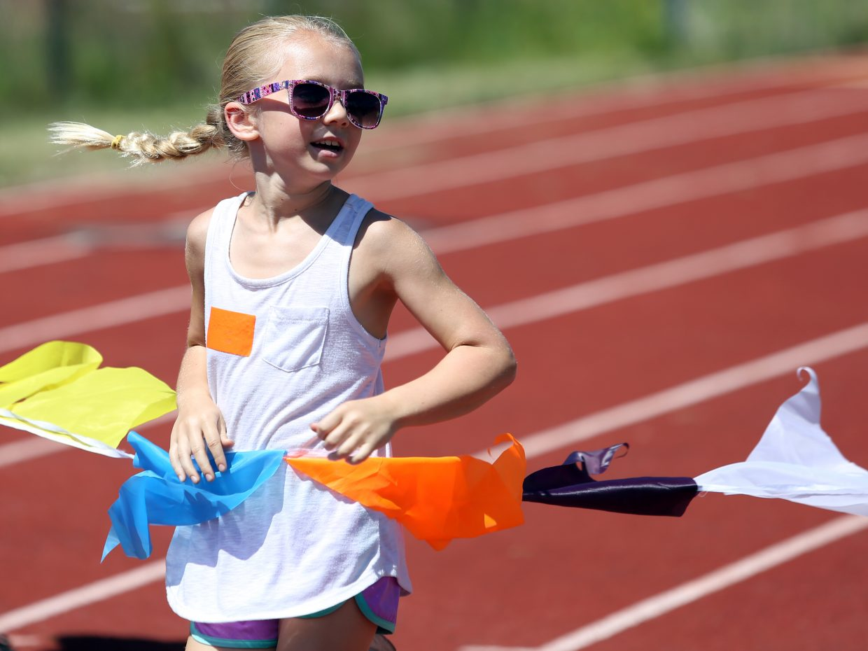 Mia Satkiewicz, 8, competes in a running event at a youth track and field camp hosted by Steamboat Springs High School on Friday, June 26 at the SSHS track. The week-long camp ended Friday with a mock track meet at the high school.