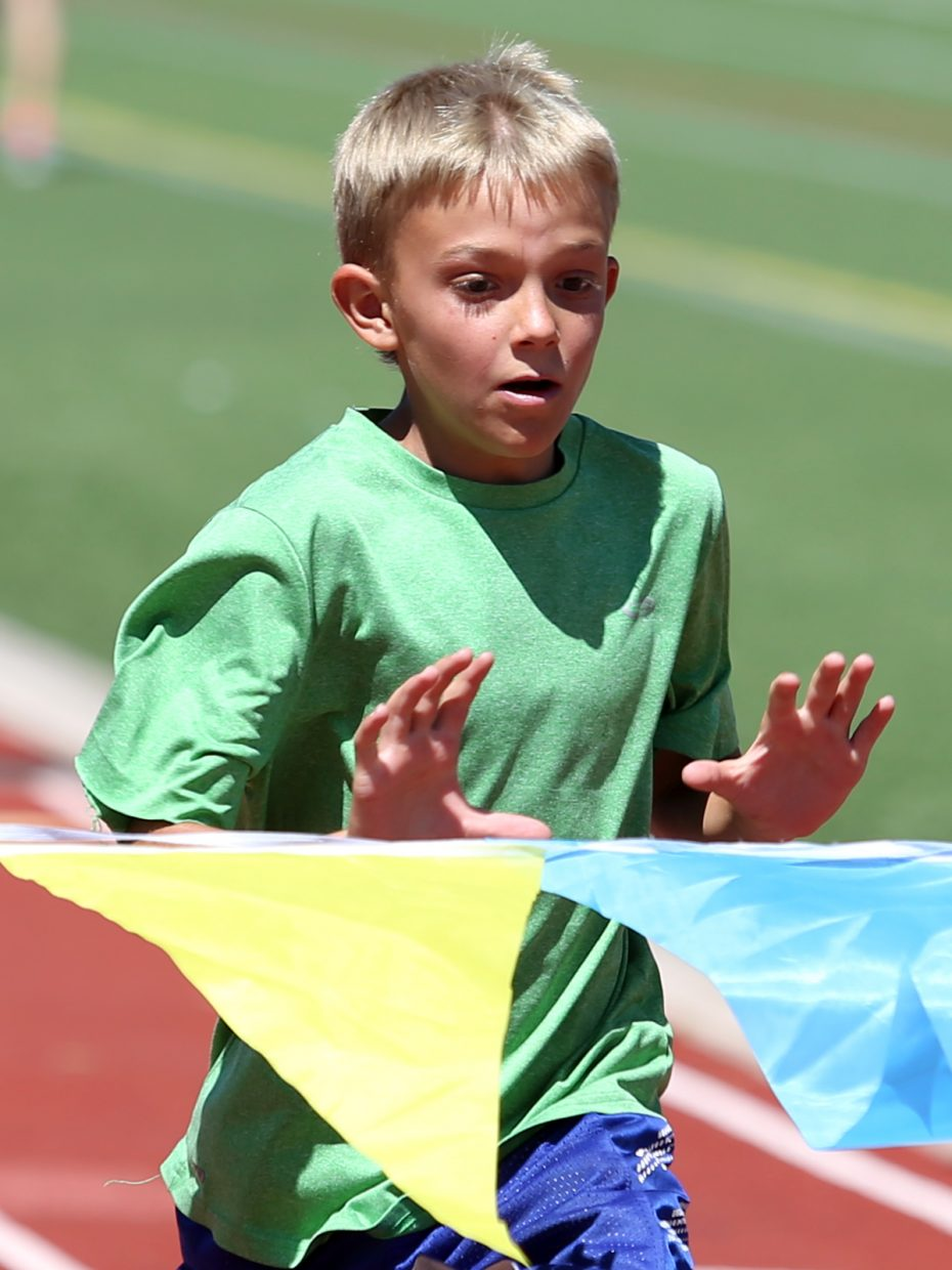 Children compete at a youth track and field camp hosted by Steamboat Springs High School on Friday, June 26, 2015, at the SSHS track. The week long camp ended Friday with a mock track meet at the high school.