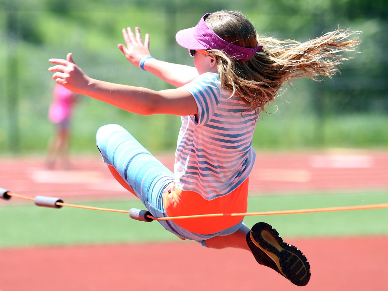 Children compete in the high jump at a youth track and field camp hosted by Steamboat Springs High School on Friday, June 26, 2015, at the SSHS track. The week long camp ended Friday with a mock track meet at the high school.