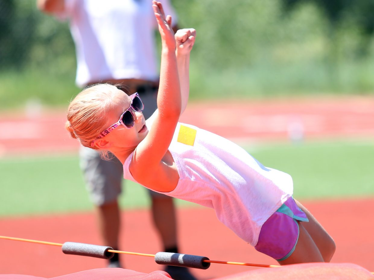 Mia Satkiewicz competes in the high jump at a youth track and field camp hosted by Steamboat Springs High School on Friday, June 26, 2015, at the SSHS track. The week long camp ended Friday with a mock track meet at the high school.