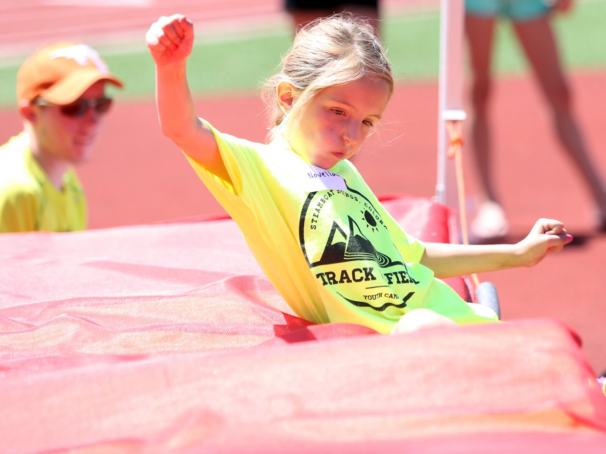 Novella competes in the high jump at a youth track and field camp hosted by Steamboat Springs High School on Friday, June 26, 2015, at the SSHS track. The week long camp ended Friday with a mock track meet at the high school.