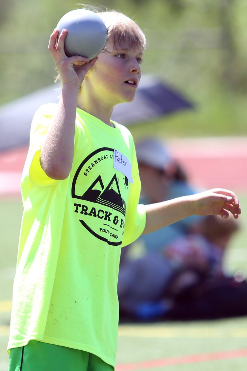 Peter competes in the shot put at a youth track and field camp hosted by Steamboat Springs High School on Friday, June 26, 2015, at the SSHS track. The week long camp ended Friday with a mock track meet at the high school.