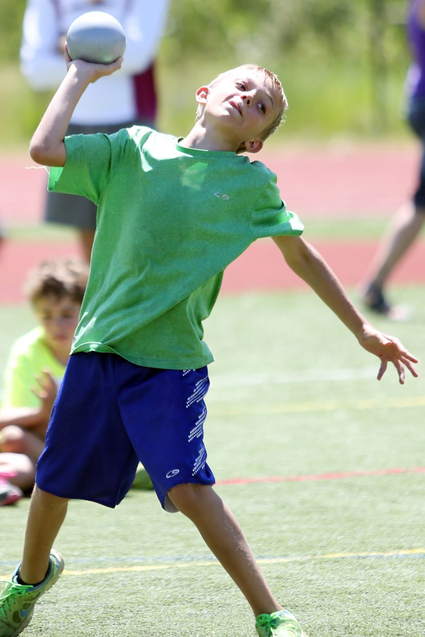 Children compete in the shot put at a youth track and field camp hosted by Steamboat Springs High School on Friday, June 26, 2015, at the SSHS track. The week long camp ended Friday with a mock track meet at the high school.
