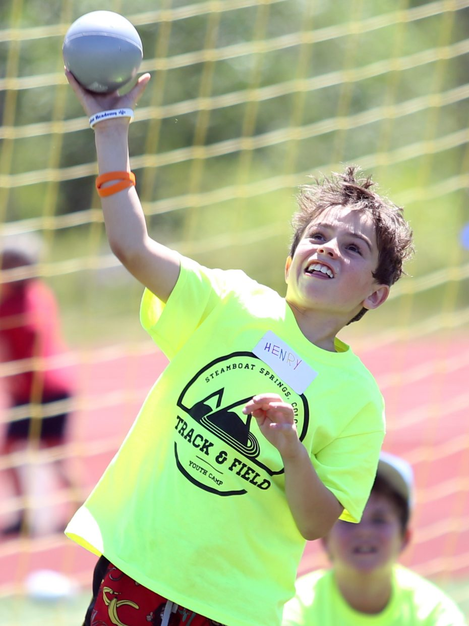 Henry competes in the shot put at a youth track and field camp hosted by Steamboat Springs High School on Friday, June 26, 2015, at the SSHS track. The week long camp ended Friday with a mock track meet at the high school.