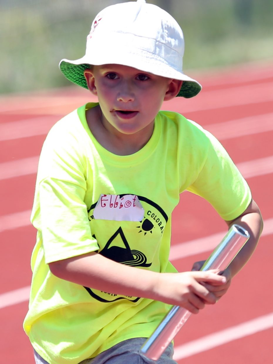 Elliot competes in a relay at a youth track and field camp hosted by Steamboat Springs High School on Friday, June 26, 2015, at the SSHS track. The week long camp ended Friday with a mock track meet at the high school.