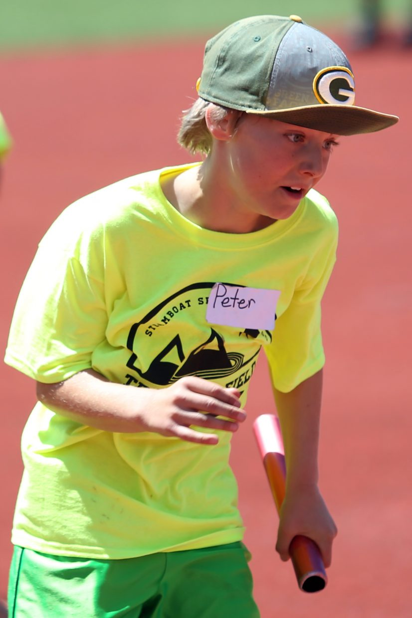 Peter competes in a relay at a youth track and field camp hosted by Steamboat Springs High School on Friday, June 26, 2015, at the SSHS track. The week long camp ended Friday with a mock track meet at the high school.