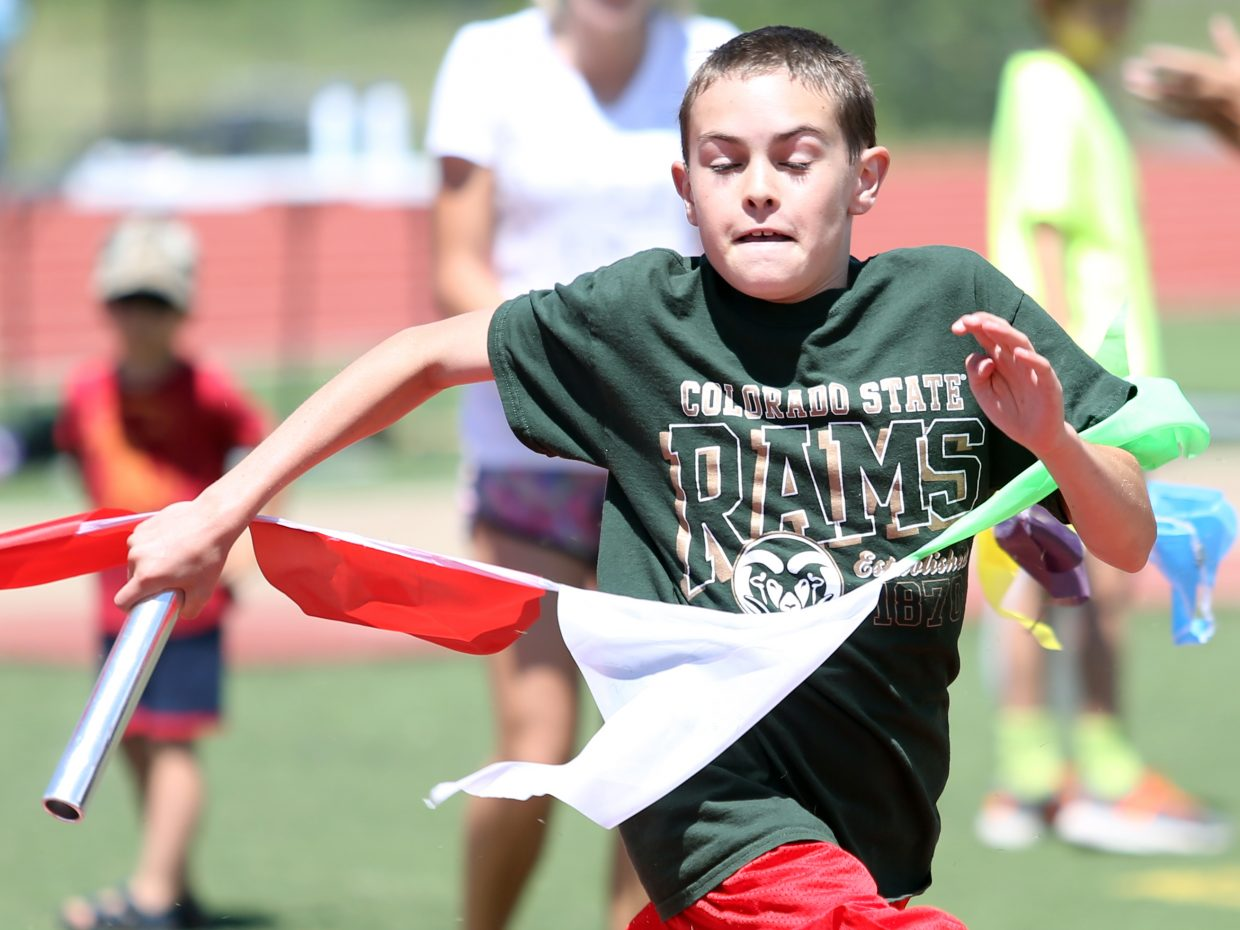 Children compete in a relay at a youth track and field camp hosted by Steamboat Springs High School on Friday, June 26, 2015, at the SSHS track. The week long camp ended Friday with a mock track meet at the high school.