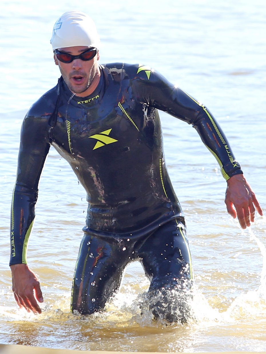 Golden's Brian Folts gets out of the water and heads toward the bike rack during the Olympic race of the Tri the Boat triathlon on Saturday, June 27, 2015, at Stagecoach State Park.