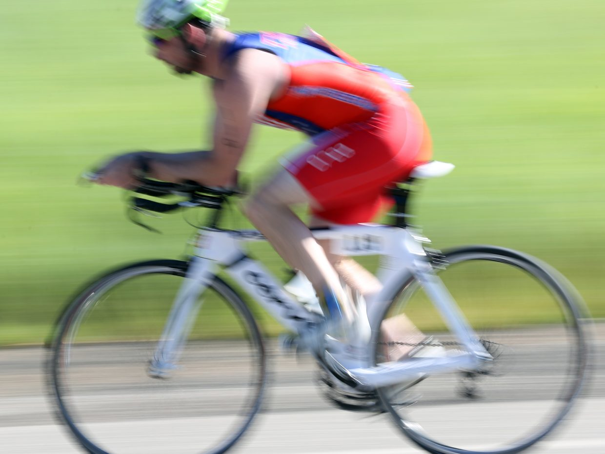 A cyclist speeds down the road during the Tri the Boat triathlon on Saturday, June 27, 2015, at Stagecoach State Park.