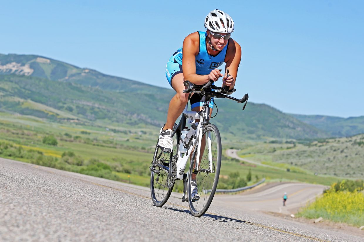 A cyclist competes in the Tri the Boat triathlon on Saturday, June 27, 2015, near Stagecoach State Park.
