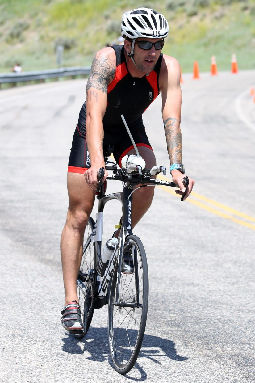 A cyclist competes in the 2015 Tri the Boat half-Ironman triathlon on Sunday, June 28, 2015, at Stagecoach State Park.