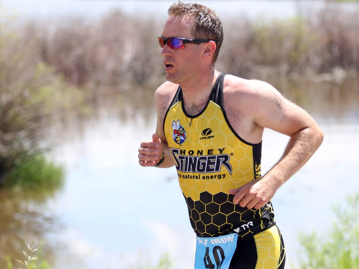 Greg Jaeger competes in the running portion of the half-Ironman triathlon Sunday, June 28, at Stagecoach State Park. Aid stations were a big part of keeping athletes cool during the run.