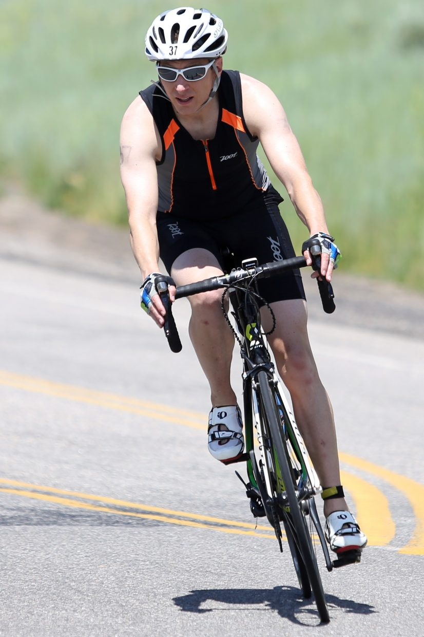A cyclist finishes his 56-mile ride before beginning the 13.1-mile run of the 2015 Tri the Boat half-Ironman triathlon on Sunday, June 28, 2015, at Stagecoach State Park.