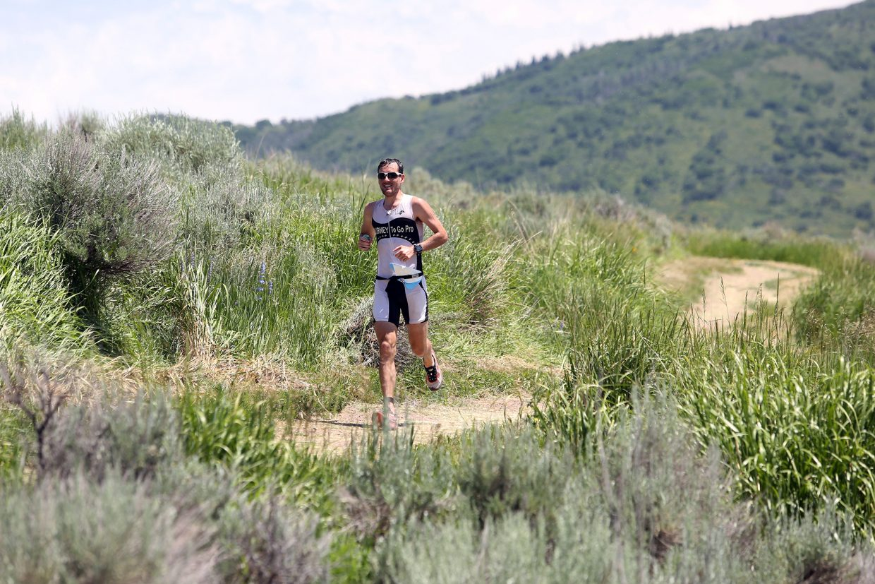 A runner finds himself alone on the trail during the 2015 Tri the Boat half-Ironman triathlon on Sunday, June 28, 2015, at Stagecoach State Park.