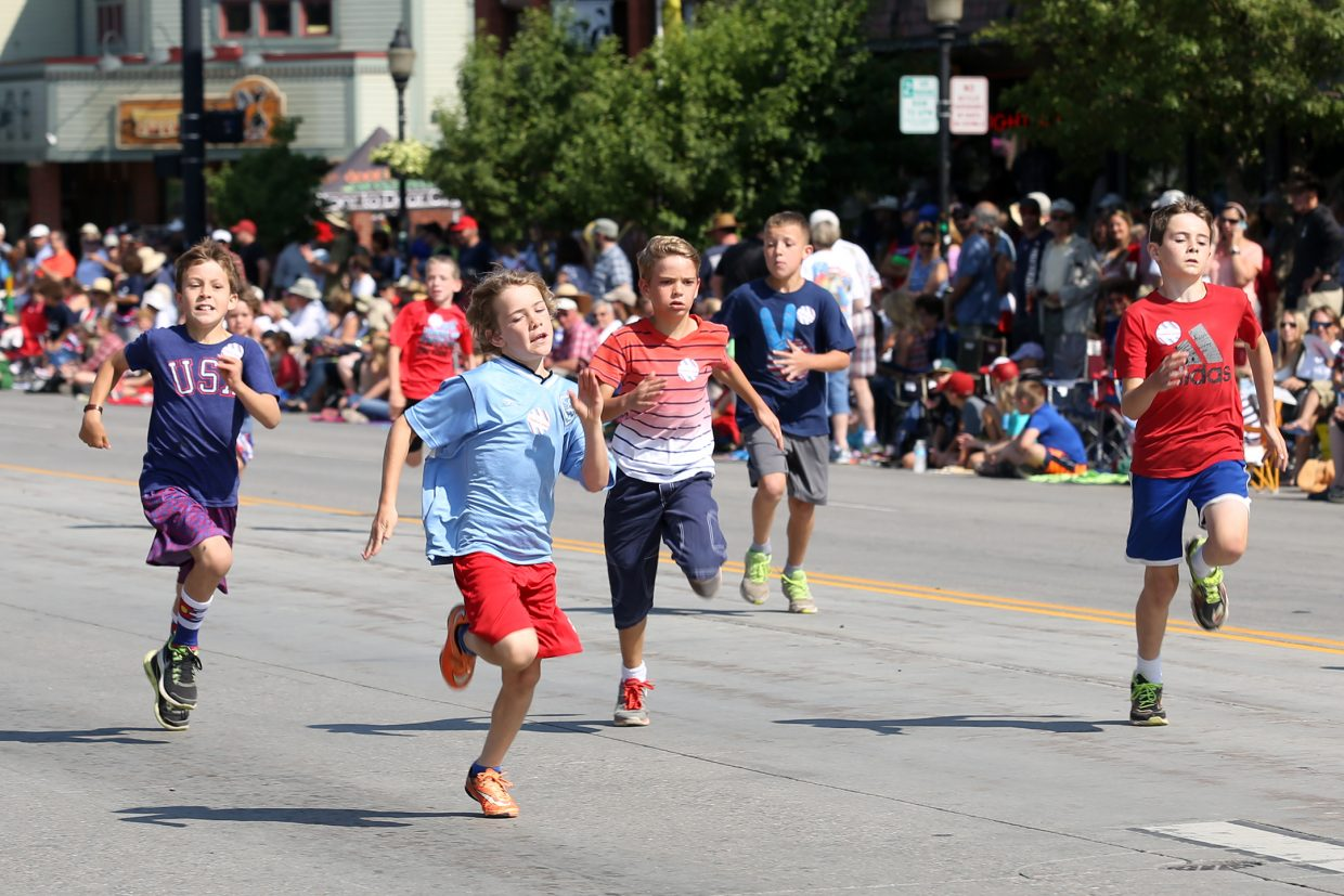 Children compete in the 24th annual Steamboat Sprint, a 400-yard dash down Lincoln Avenue, prior to Saturday's Fourth of July parade in downtown Steamboat Springs.