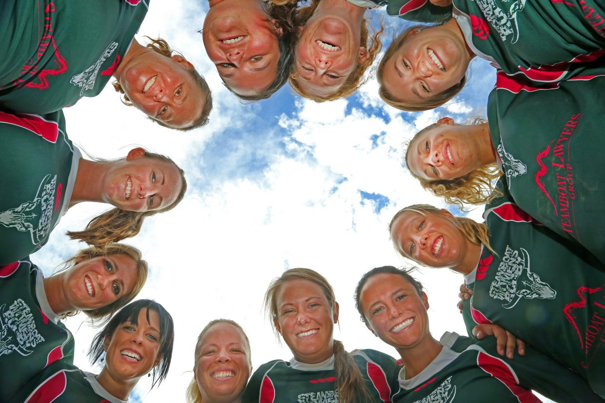 Members of the Steamboat Springs women's rugby club huddle on Friday at the Ski Town Fields prior to Saturday's Cow Pie Classic. In its fourth year, the Steamboat women's RFC is thriving and will play host to five other teams in the Classic this weekend.