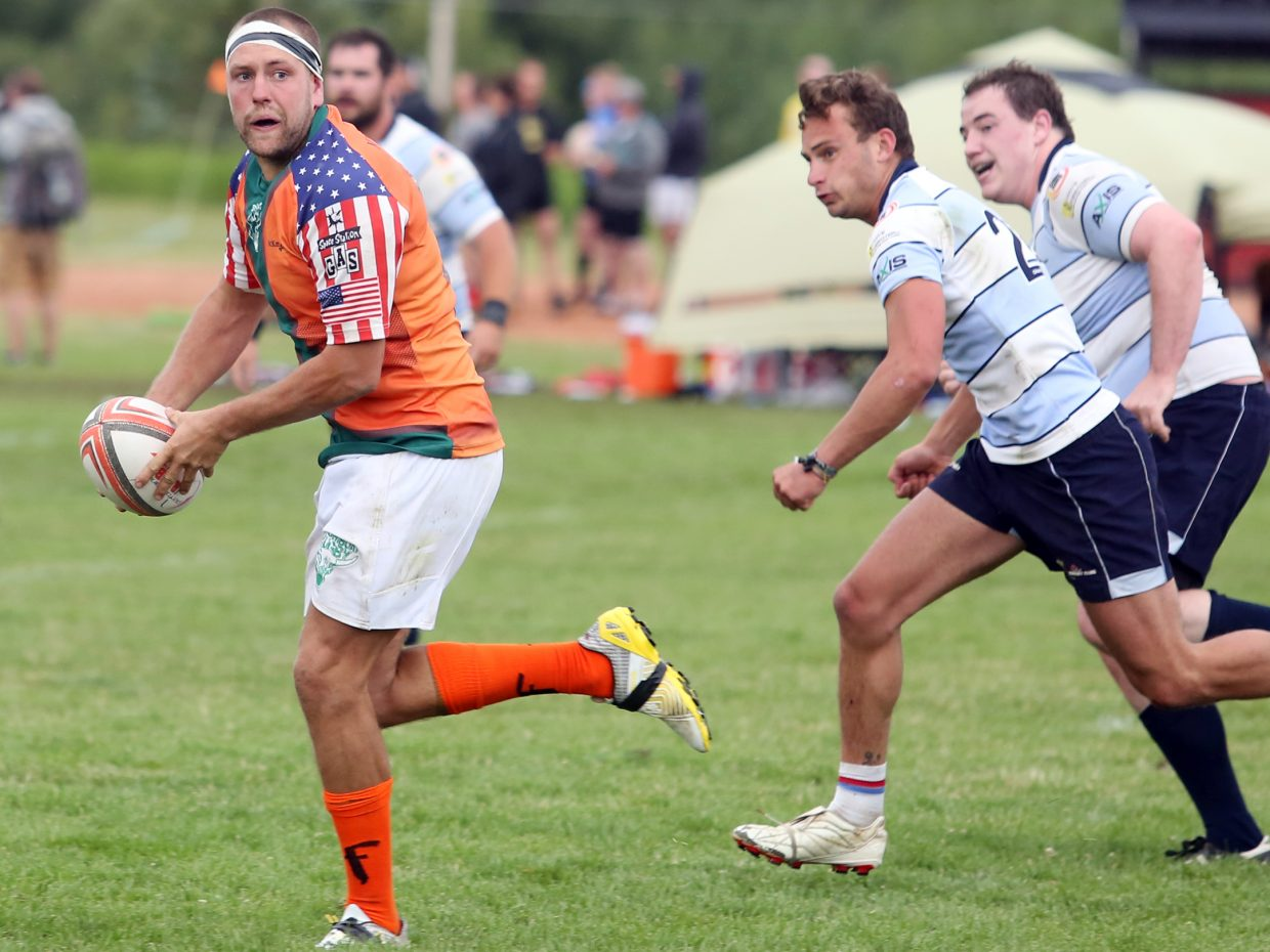 Steamboat RFC's Brendon Ridgen, left, looks back to make a pitch against Vail RFC during their semifinal match on Saturday in the 41st annual Cow Pie Classic at the Ski Town Fields in Steamboat Springs. Vail won, 7-5.