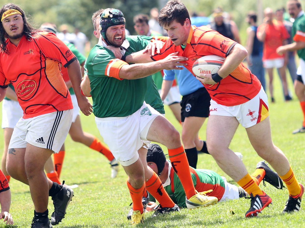Steamboat RFC against New Mexico RFC during their match on Saturday in the 41st annual Cow Pie Classic at the Ski Town Fields in Steamboat Springs.