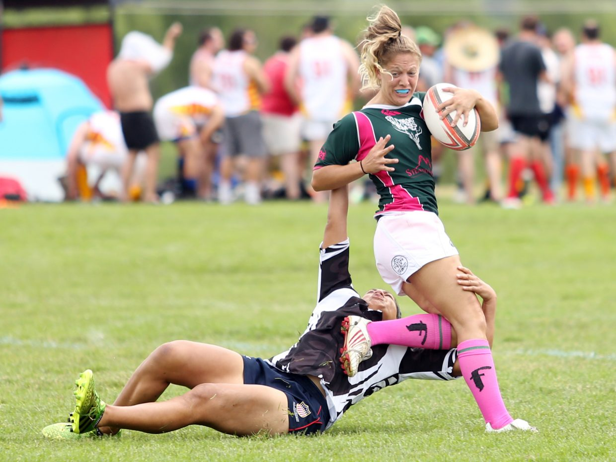 Steamboat RFC's Heather Biewick, right, attempts to get away from a Salt Lake City RFC player during their final match on Saturday in the 41st annual Cow Pie Classic at the Ski Town Fields in Steamboat Springs.