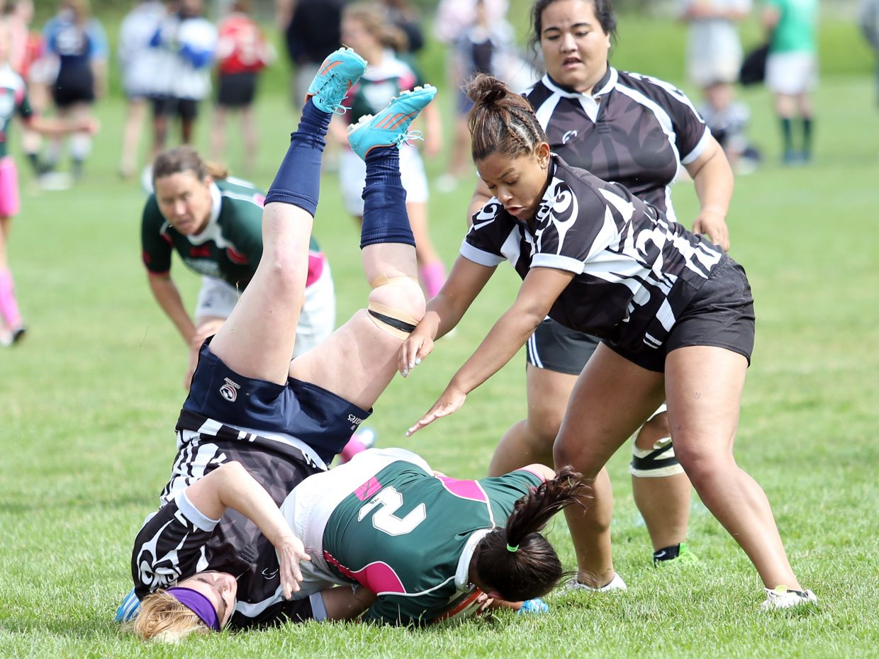 """Steamboat women's RFC player Tash Carns (No. 2) hits the ground in a battle for possession against the Salt Lake City Vipers """"B"""" team on Saturday in the 41st annual Cow Pie Classic at the Ski Town Fields in Steamboat Springs."""