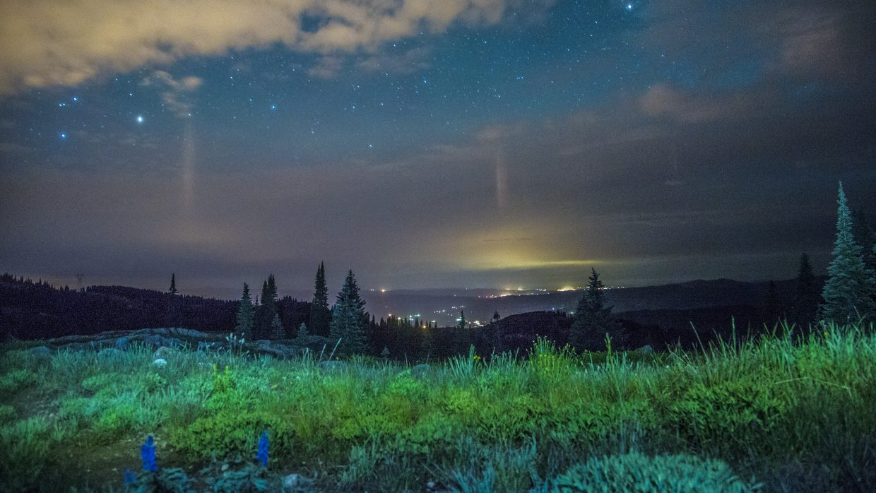 Steamboat Springs shines under a cloudy but star-filled sky early Tuesday morning, as seen from 10,000 feet of elevation on Buffalo Pass. Located a short drive outside of town, Buffalo Pass is among the area's best and most popular camping spots.