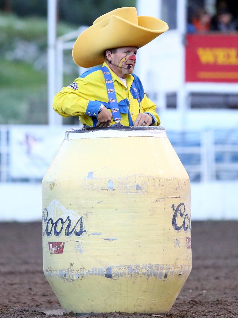 Rodeo clown Troy Lerwill hides in his barrel during Saturday's Steamboat Springs Pro Rodeo Series event at Brent Romick Arena.