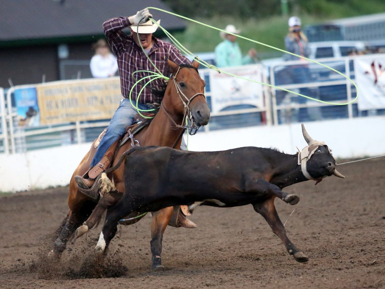 Ryon Tittel, of Pueblo, competes in the team roping competition of Saturday's Steamboat Springs Pro Rodeo Series at Brent Romick Arena.