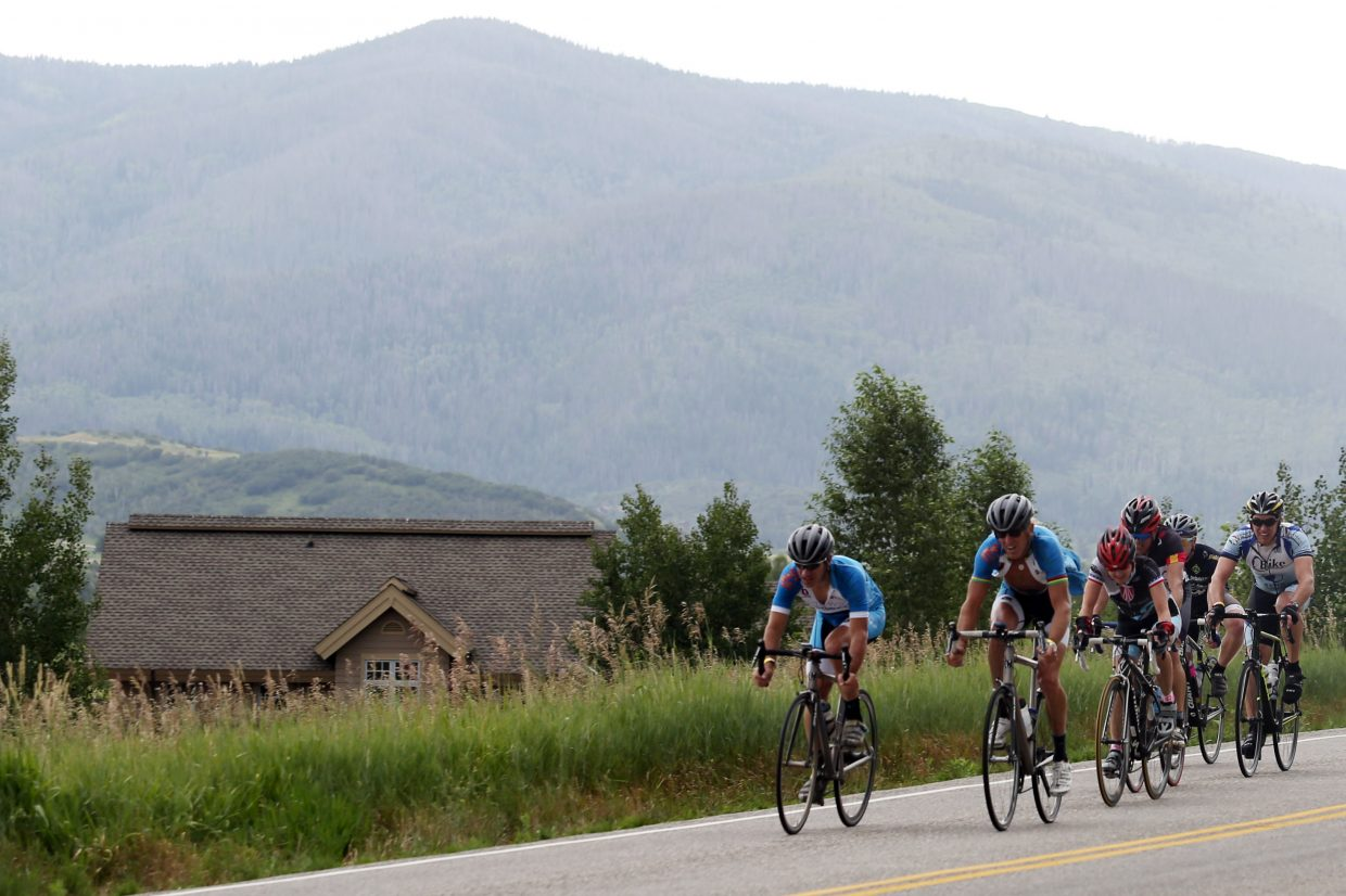 A group of cyclists ride along River Road in Steamboat Springs on Saturday as they near the completion of the 12th annual Tour de Steamboat charity ride.