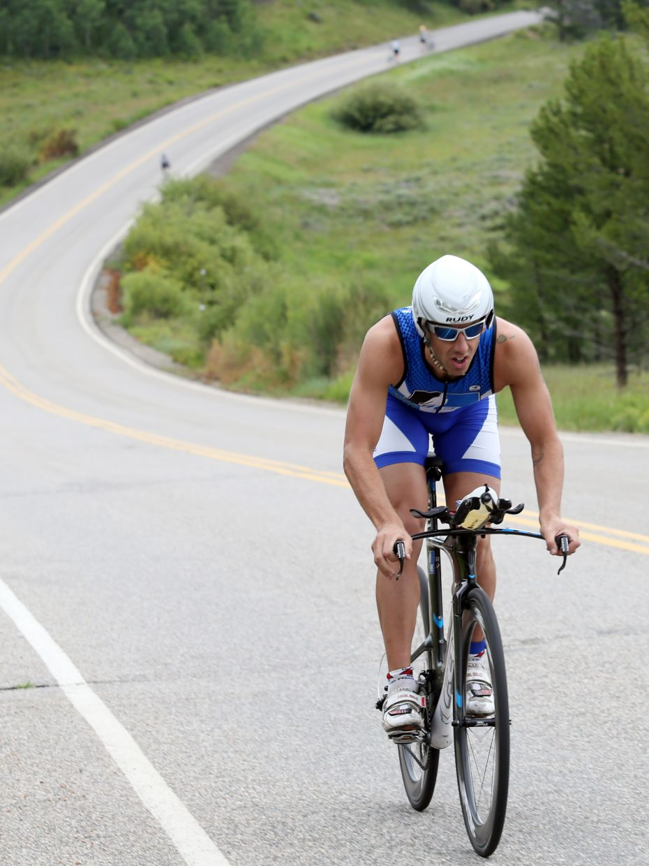 Boulder's Eric Kenney enters the final stretch of the 12.4-mile bike ride, the second stage of Sunday's Steamboat Lake Sprint Triathlon. Kenney won the triathlon with a time of 1 hour, 6 minutes and 43.6 seconds.