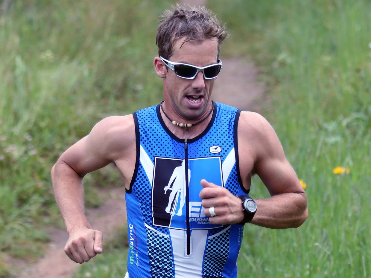 Boulder's Eric Kenney competes in Sunday's Steamboat Lake Sprint Triathlon. Kenney finished first among all athletes.