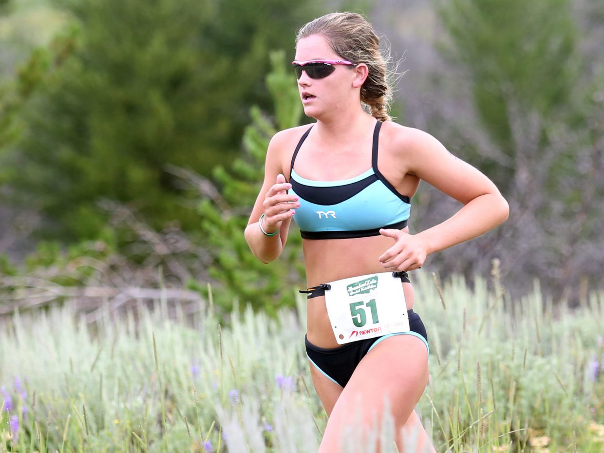 Colorado Springs native Taylor Fogg approaches the end of her 3.1-mile run, the final stage of Sunday's Steamboat Lake Sprint Triathlon. Fogg, a student at Columbia University in New York, was the top overall female with a time of 1 hour, 15 minutes, 55.6 seconds, good for sixth overall.