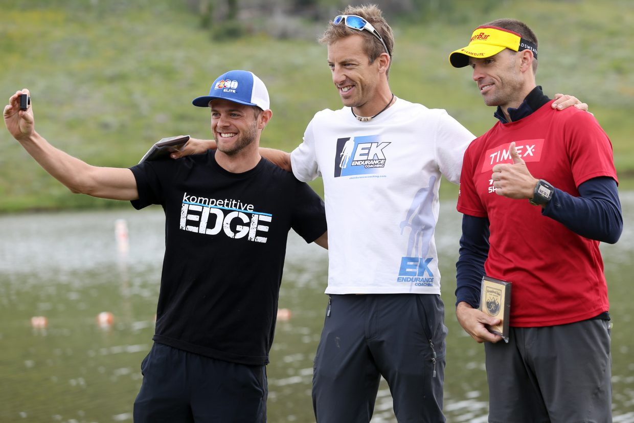From left, Boulder's Kenny Withrow (third place), Boulder's Eric Kenney (first place) and Highlands Ranch's Tim Hola (second place) pose on the podium following Sunday's running of the fifth annual Steamboat Lake Sprint Triathlon at Steamboat Lake State Park.