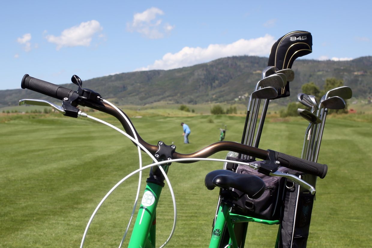 Steamboat Springs resident Devin Patrick Lightheart enjoys a round of golf using The Golf Bike. Created in 2010 by Florida-based Higher Ground Golf Co. president Todd May, the bike is this summer's newest attraction at Haymaker Golf Course in Steamboat Springs. For $15, golfers can rent out these bikes for 18 holes, a healthier option than the traditional motorized golf cart.