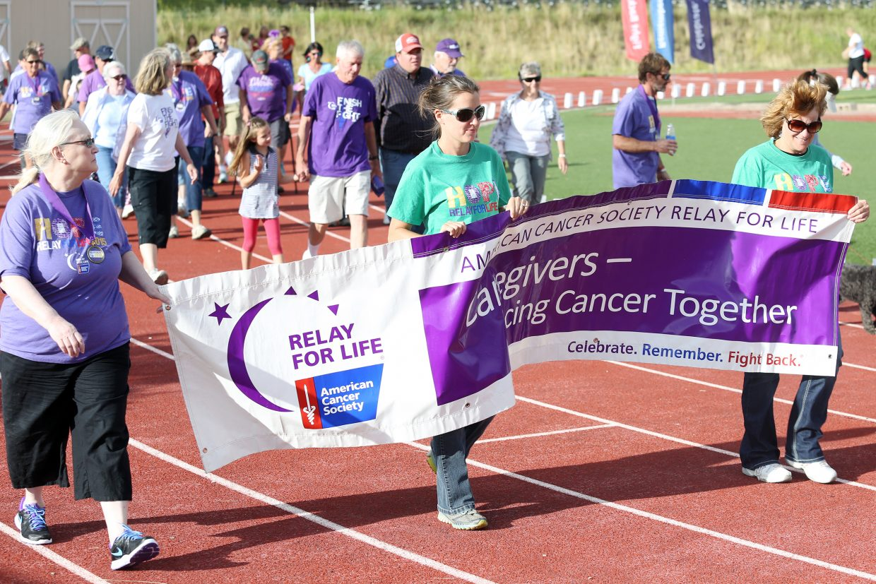 Participants take part in the opening ceremony of Friday's Relay for Life 2015 Wish Upon a Cure event at the Steamboat Springs High School track. Relay for Life, in its 30th year, raises money for the American Cancer Society.
