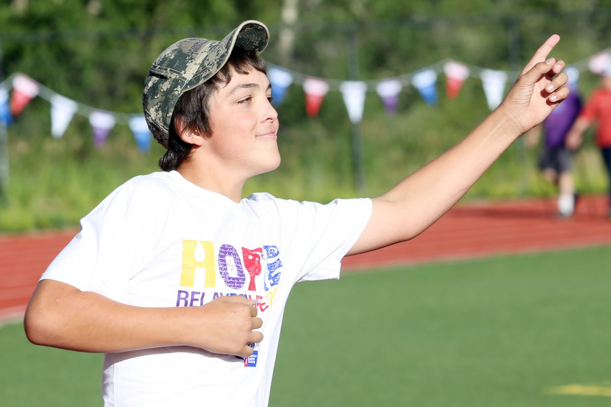Hayden's Garrett Salazar, 13, dances his way around the track during Friday's Relay for Life 2015 Wish Upon a Cure event at Steamboat Springs High School. Salazar was honoring his late grandfather who died of pancreatic cancer.