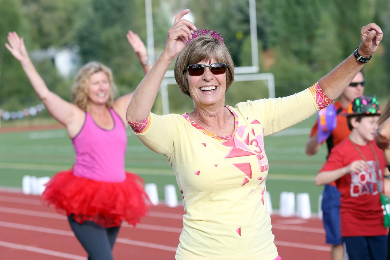 Sue Raub, with the Old Town Hot Springs Zumba team, takes part in Friday's Relay for Life 2015 Wish Upon a Cure event at the Steamboat Springs High School track. Relay for Life, in its 30th year, raises money for the American Cancer Society.