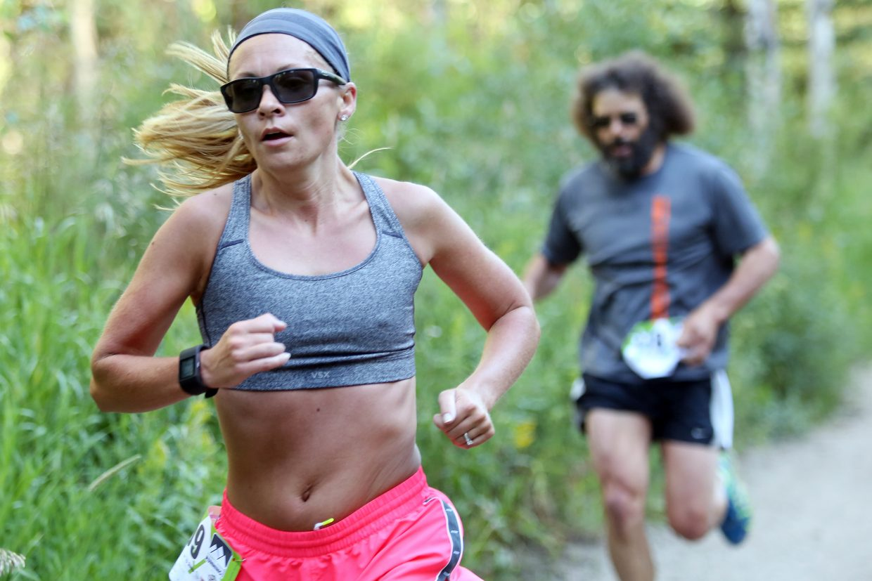 Craig's Sara Linsacum, left, leads Minnesota's Chick Woodward in Saturday's Spring Creek Memorial 5-kilometer trail run in Steamboat Springs. Linsacum finished 16th overall and Woodward 19th in the annual race.