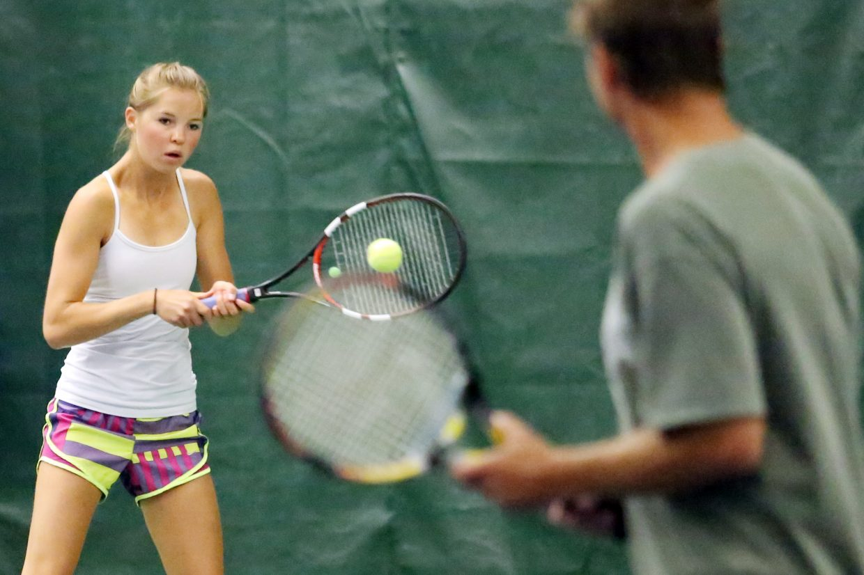 Kira Lorenzen, left, receives a serve while her father and doubles partner, Dave Lorenzen, looks on, during their match Sunday at The Tennis Center at Steamboat Springs. The pair went 2-0 over the weekend to win the Combined Mixed 9.0 Doubles round robin of the 2015 Steamboat Tennis Association Summer Championships.