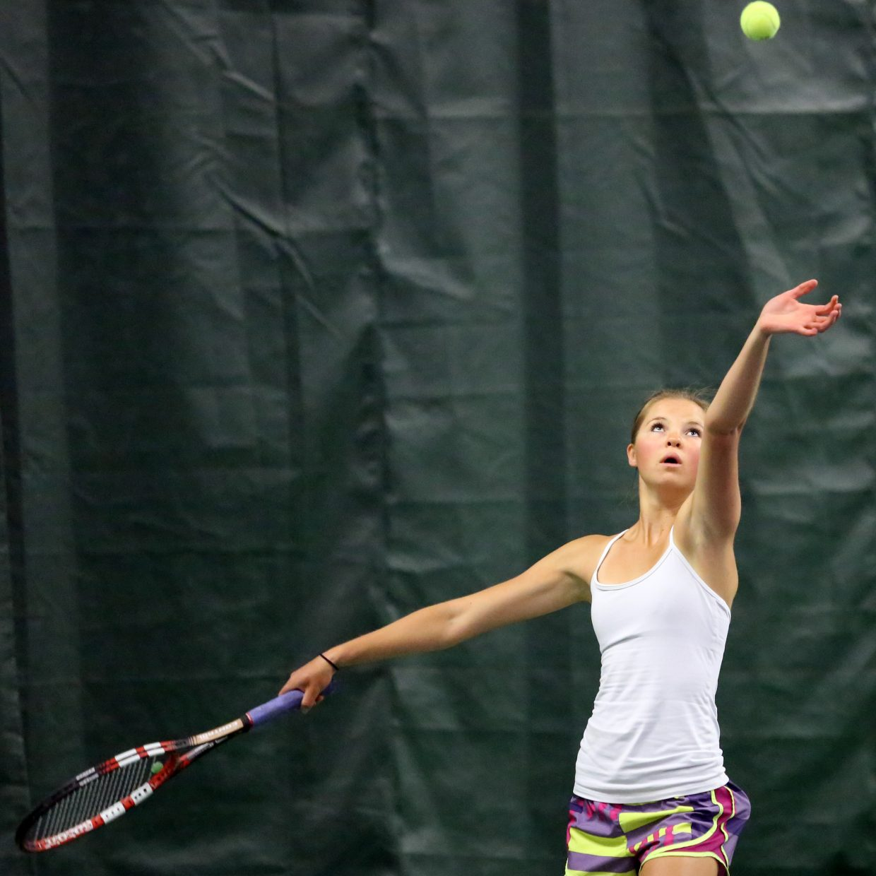 Steamboat's Kira Lorenzen prepares to serve as she plays alongside her father, Dave Lorenzen, Sunday at The Tennis Center at Steamboat Springs.
